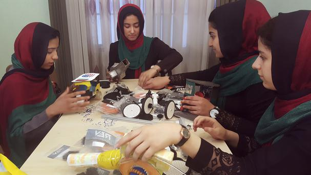 Teenage girls from the Afghanistan Robotic House, a private training institute, practise in Herat (Ahmad Seir/AP)