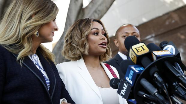 Blac Chyna talks to the media while standing with her lawyer Lisa Bloom left