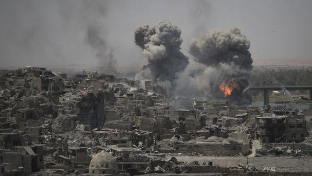 Air strikes target Islamic State positions on the edge of the Old City in Mosul (Felipe Dana/AP)