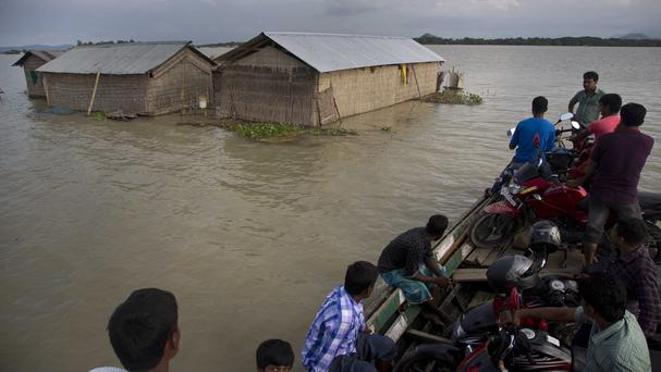 Flooding and landslides in Assam have killed at least 28 people since mid-June (AP)