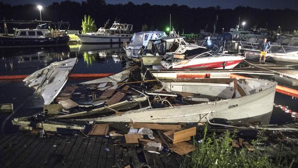 The destroyed yacht Gina lies in the harbour in Minden, Germany (Federico Gambarini/dpa via AP)