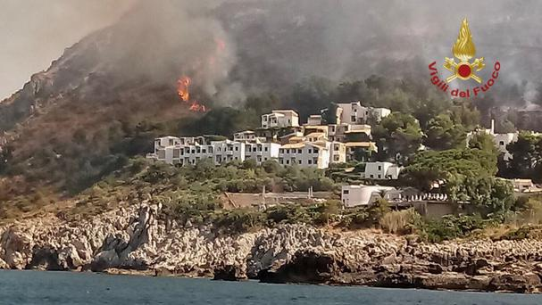 Fires burn near a resort where, according to reports, several hundred tourists have been evacuated (Italian Firefighters Vigili del Fuoco via AP)