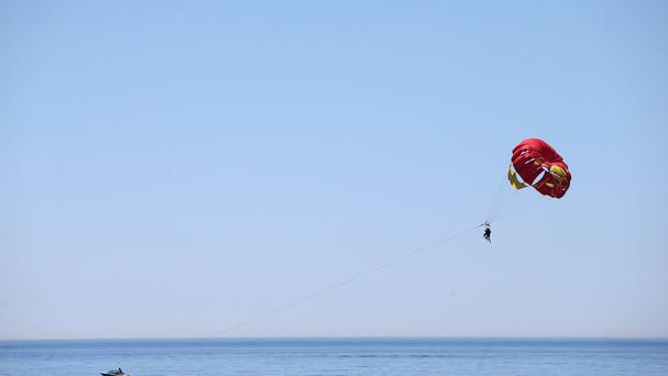 Water sports such as parasailing are popular in tourist destinations like Phuket, but safety measures are not always strictly enforced