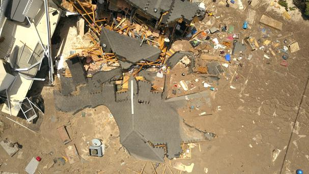 Debris is strewn about after a sinkhole damaged two homes in Land O' Lakes, Florida. (AP)