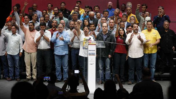 Opposition leaders after more than seven million people rejected a government plan to rewrite the constitution (AP)