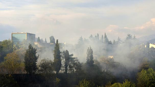 Smoke rises over the Montenegro capital Podgorica as firefighters try to contain wildfires along the Adriatic coast (AP)