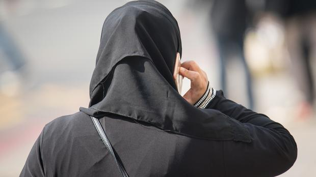 Women in Saudi Arabia are expected to wear long, loose robes in public