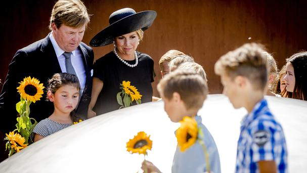 King Willem-Alexander and Queen Maxima during the unveiling of the monument for the MH17 victims (Remko de Waal/via AP)