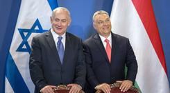 Benjamin Netanyahu and Viktor Orban at a signing ceremony in Budapest (MTI/AP)