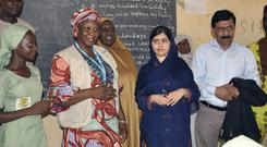 Pakistani activist Malala Yousafzai, centre right, during a visit to a school in Maiduguri, Nigeria (AP Photo/ Jossy Ola)