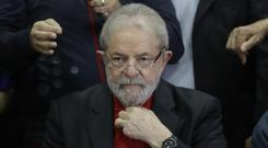 Former Brazilian President Luiz Inacio Lula da Silva denies any wrongdoing and remains free pending a decision on his appeal (AP)