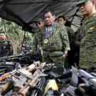 Philippine President Rodrigo Duterte inspects firearms recovered from Muslim militants in Marawi city. (AP)