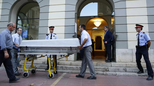 Workers take a casket to the Dali Theatre Museum in Figueres (AP Photo/Manu Fernandez)