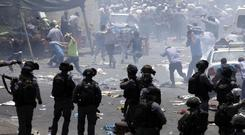 Violence has escalated in Jerusalem over the introduction of metal detectors at a contested shrine