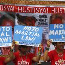 Protesters during the special joint session that decided to extend martial law in the southern Philippines (AP/Bullit Marquez)