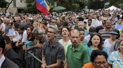 People sing Venezuela's national anthem at a swearing-in ceremony for newly named Supreme Court justices, in Caracas (AP)