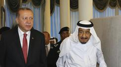 Turkey's President Recep Tayyip Erdogan, left, walks with Saudi King Salman (AP)