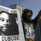 A protester during a demonstration demanding former University of Cincinnati police officer Ray Tensing be retried for murder over the shooting death of motorist Sam DuBose (AP)