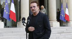 U2 singer Bono speaks to the media after a meeting at the Elysee Palace in Paris (Michel Euler/AP)