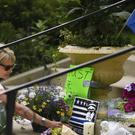 Linden Hills resident Robyn Traxler places flowers at the memorial for Justine Damond on the steps of the Lake Harriet Spiritual Community church in south Minneapolis (Star Tribune/AP)