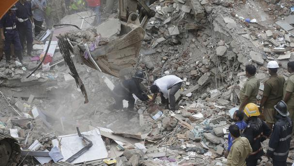 Three killed, dozens feared trapped in Mumbai building collapse