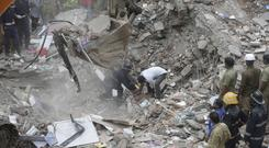 Rescuers work on the debris after a five-storey building collapsed in the Ghatkopar area of Mumbai (AP)