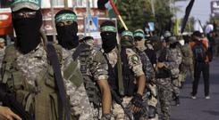 Masked militants from a military wing of Hamas, which was listed as a terror group in 2001 (Adel Hana/AP)