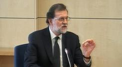 Spain's Prime Minister Mariano Rajoy gives evidence at Spain's National Court (EFE TV, POOL via AP)