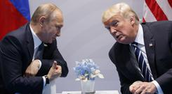 US President Donald Trump meets Russian President Vladimir Putin at the G20 Summit in Hamburg (AP)