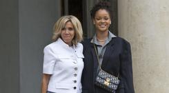 Brigitte Macron, left, the wife of French President Emmanuel Macron, welcomes Rihanna at the Elysee Palace (AP)