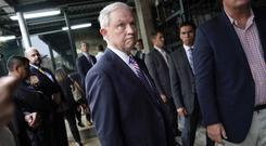 US attorney general Jeff Sessions pauses near the end of a tour of local police station and detention centre in San Salvador, El Salvador (AP)