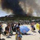 Sunbathers are being evacuated from the beach in Le Lavandou (AP)