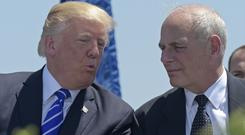Donald Trump, left, pictured with John Kelly in May (AP)
