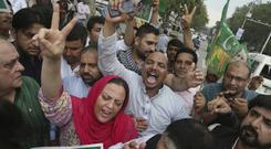 Supporters of Pakistan's ruling Muslim League party rally in support of their leader Nawaz Sharif after the Supreme Court ruling (AP Photo/KM Chaudary)