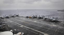 F18 aircraft on the US Navy carrier USS Nimitz (Rishi Lekhi/AP)