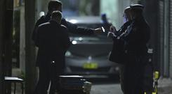 Police in in the Surry Hills suburb of Sydney during the raid (AAP Image/AP)