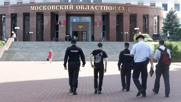 Police officers outside the main entrance of Moscow Regional Court (Andrey Nikerichev/Moscow News Agency via AP)