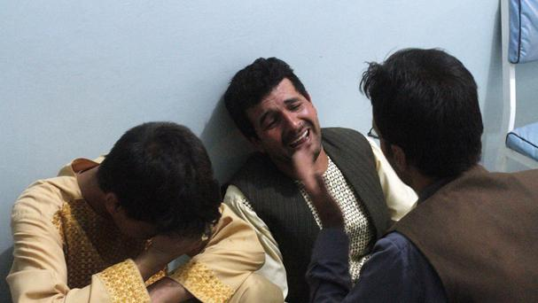 Relatives mourn after a suicide attack on a mosque in Heart, Afghanistan. (AP)