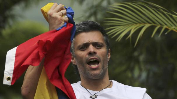 Leopoldo Lopez outside his home in Caracas following his release from prison after more than three years - the opposition leader has now been arrested again (AP Photo/Fernando Llano, File)