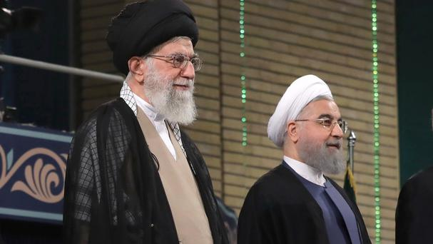 Ayatollah Ali Khamenei, left, and President Hassan Rouhani at the start of the official endorsement ceremony of President Rouhani in Tehran (Office of the Iranian Supreme Leader via AP)