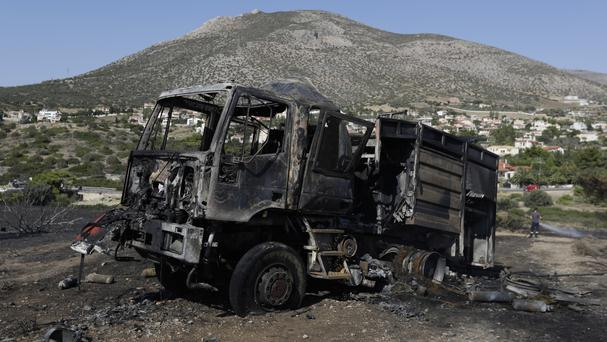 A burned-out fire engine during a wildfire near Kalyvia in Greece (Thanassis Stavrakis/AP)