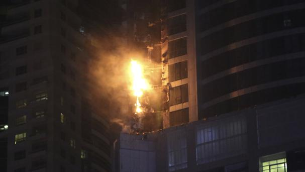 Smoke and fire at the Torch Tower in Dubai's Marina district (AP Photo/Kamran Jebreili)
