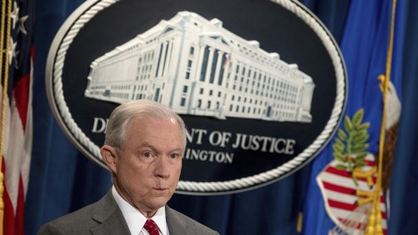 Attorney general Jeff Sessions attends a news conference at the Justice Department in Washington (Andrew Harnik/AP)