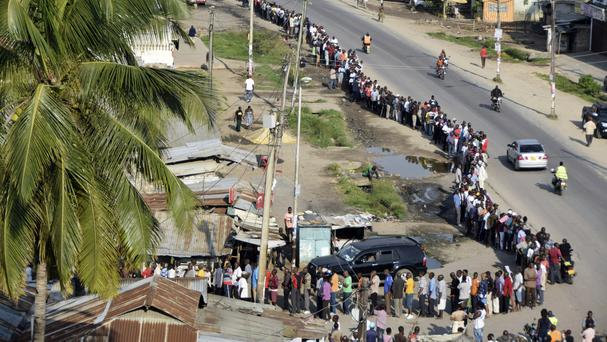 Voters queue to cast their votes at Ziwa la Ng'ombe polling station in Mombasa (AP)