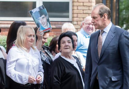 Norman Bettison walks past Jenny Hicks, left, and other friends and family of victims as he arrives at Warrington Magistrates' Court. Photo: Danny Lawson/PA Wire