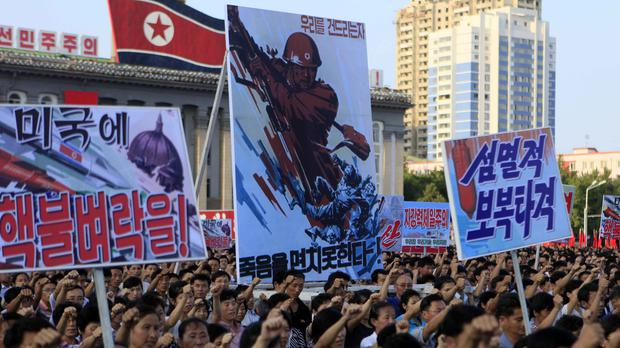Tens of thousands of North Koreans gather for a rally at Kim Il Sung Square (Jon Chol Jin/AP)