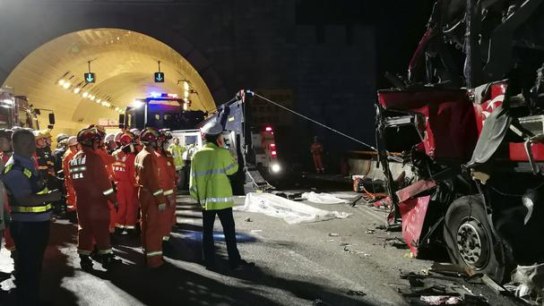 Rescuers at the site of the crash (Xinhua/AP)