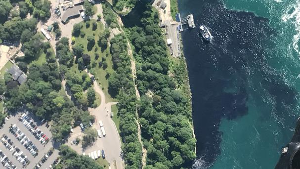 Black-coloured waste water treatment discharge is released into water below Niagara Falls. (AP)