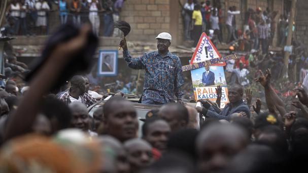 Kenyan opposition leader Raila Odinga leaves in his vehicle surrounded by thousands of supporters (Ben Curtis/AP)