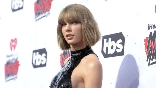 Taylor Swift said she wanted a symbolic 1 dollar and the chance to stand up for other women (Photo by Richard Shotwell/Invision/AP, File)